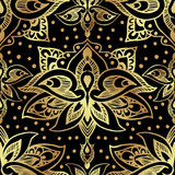 Elegant seamless pattern with royal lilies. Golden flowers on a black background. Royalty Free Stock Photography