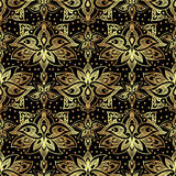 Elegant seamless pattern with royal lilies. Golden flowers on a black background. Royalty Free Stock Image