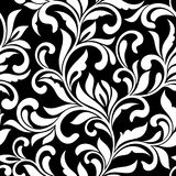 Elegant seamless pattern. Tracery of swirls and decorative leaves on a black background. Vintage style. It can be used for printing on fabric, wallpaper Stock Photography