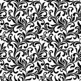 Elegant seamless pattern. Tracery of swirls and leaves Royalty Free Stock Photos