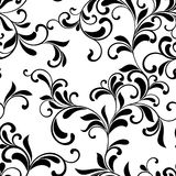 Elegant seamless pattern. Tracery of swirls and leaves  on a whi Stock Photography