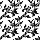 Elegant seamless pattern. Tracery of swirls and leaves on a whit Royalty Free Stock Images