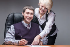Elegant secretary and boss Royalty Free Stock Images
