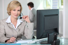 Elegant secretary with headset Royalty Free Stock Photo