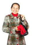 Elegant senior lady in overcoat Stock Photos