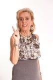 Elegant senior lady raising her finger Stock Photo