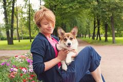 Elegant Senior Woman Cuddling Her Dog Pet Outdoor Royalty Free Stock Photo