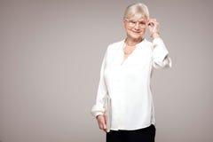 Elegant senior woman in studio. Stock Images