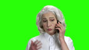 Elegant senior woman talking on mobile phone. stock footage