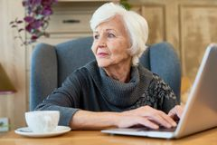 Elegant Senior Woman Using Laptop Stock Photography