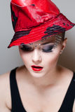 Elegant young woman with red hat & crystals Stock Images