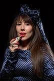 Elegant sensual woman applying red lipstick Stock Photography
