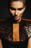 Elegant sensual woman in leather accessory. In dark Royalty Free Stock Images