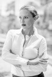 Elegant Serious Business Woman. Posing With Arms Folded on Black and White Photo Stock Image