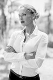 Elegant Serious Business Woman. Posing With Arms Folded on Black and White Photo Royalty Free Stock Images