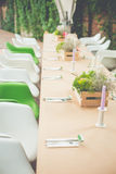 Elegant Served Restaurant Tables on wooden terrace Stock Photo