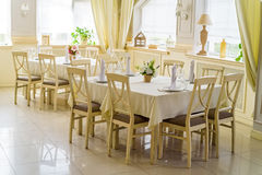 Elegant served tables and chairs indoors Royalty Free Stock Image