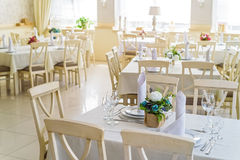 Elegant served tables and chairs indoors Stock Image