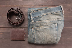 Elegant set: brown wallet, jeans and brown leather belt, on the Stock Photo