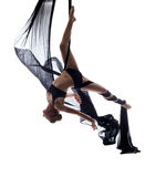 Elegant sexy dancer posing hanging on cloth Royalty Free Stock Photos