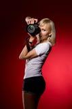 Elegant sexy girl holding a camera. Studio shot Stock Photos