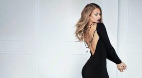 Elegant sexy woman in black dress. Stock Photos