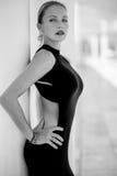 Elegant Woman Posing. In Black Dress at Malaga Harbour stock image