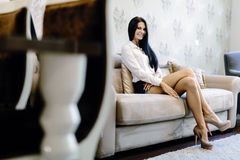 elegant sexy woman sitting sofa luxurious room smiling 61181318 - How to Attract Eastern Western european Women