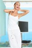 Elegant shapely woman stretching Stock Photos