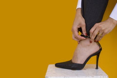 Elegant shoes. A businesswoman showing her elegant shoes Royalty Free Stock Image