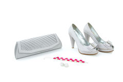 Elegant shoes, purse, earings and bracelet Stock Photo