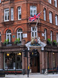 Elegant shop with Union Jack and coat of arms, London Royalty Free Stock Photos