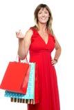 Elegant shopaholic woman carrying shopping bags Stock Photos