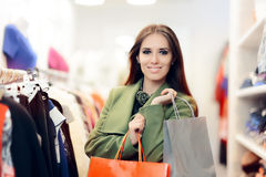 Elegant Shopping Woman Wearing a Green Coat in Fashion Store Royalty Free Stock Image