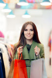 Elegant Shopping Woman Wearing a Green Coat in Fashion Store Royalty Free Stock Images