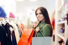 Elegant Shopping Woman Wearing a Green Coat in Fashion Store Royalty Free Stock Photography