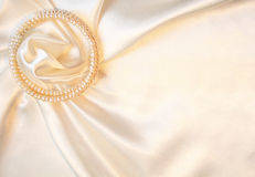 Elegant silk with pearls as wedding background Stock Images