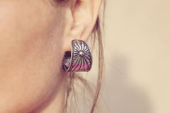 Elegant silver earring Stock Images