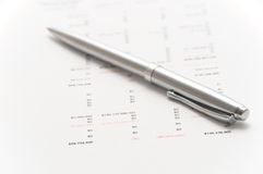 Elegant silver pen on financial papers Stock Photography