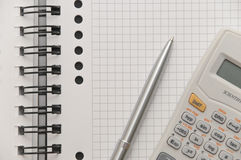 Elegant silver pen and scientific calculator Royalty Free Stock Images