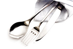 Elegant silverware inside napkin Royalty Free Stock Images