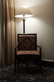 Elegant and simple interior, lamp and armchair with curtain Royalty Free Stock Photos