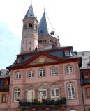 Elegant and simple palace in Mainz behind a bell tower and a large tower in Germany Stock Photo