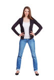 Elegant slim girl in blue jeans Royalty Free Stock Images