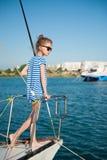 Elegant slim little girl in sunglasses aboard luxury yacht Royalty Free Stock Photography