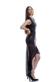 Elegant slim model posing in black cocktail dress Stock Photos
