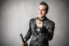 Elegant smart man with a bottle of wine stock images