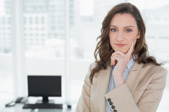 Elegant smiling businesswoman standing in office Stock Photography