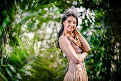 Elegant smiling lady with tiara on a head Royalty Free Stock Image