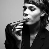 Elegant smoking woman Stock Photos